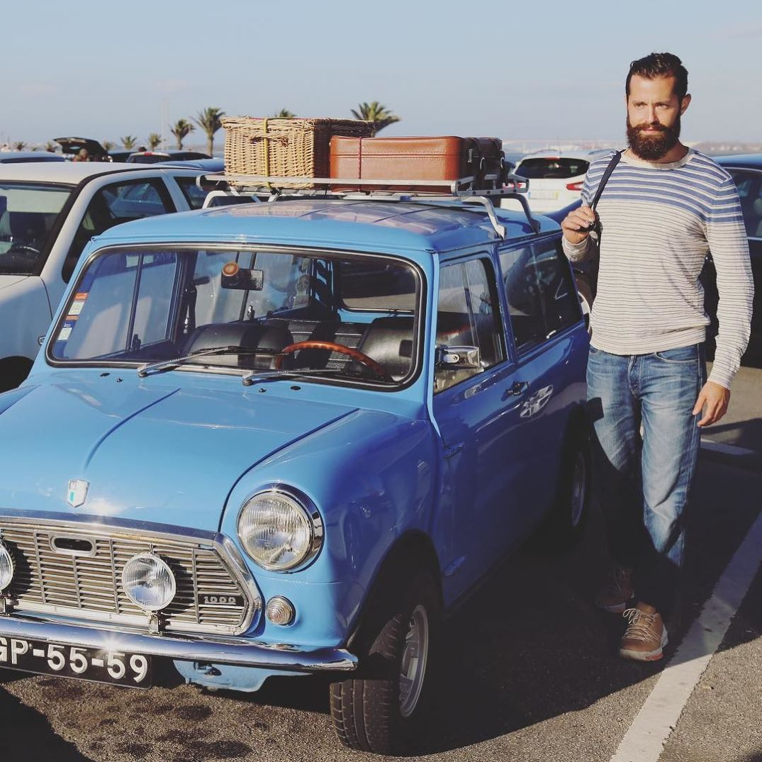 Michael Checkers with a matching vintage Mini Cooper in Portugal