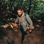 Michael Checkers wearing Khaki Green while hiking in Maine on a fall 2018 fashion trend report photo shoot