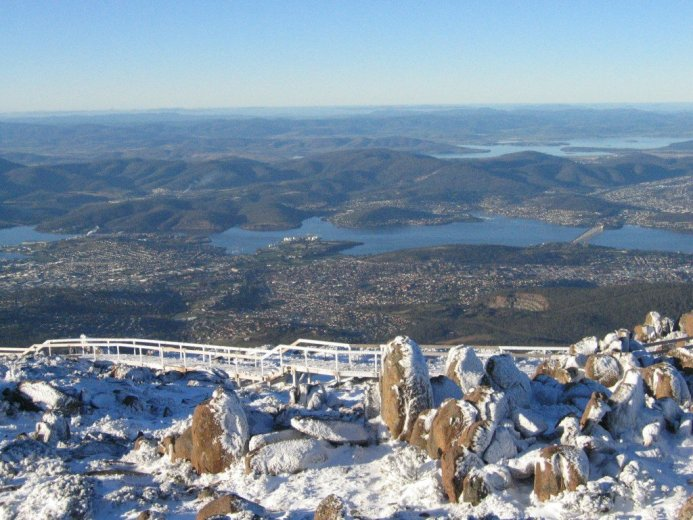 Mt Wellington summit and Hobart in winter - by Angus Munro