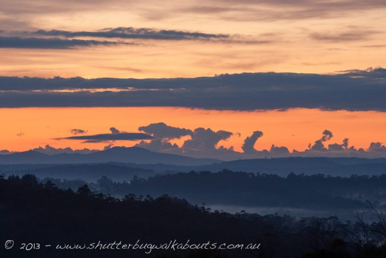 Colourful cloud patterns over the mountains with fog filled valleys-View from Margate- by Shutterbug Walkabouts
