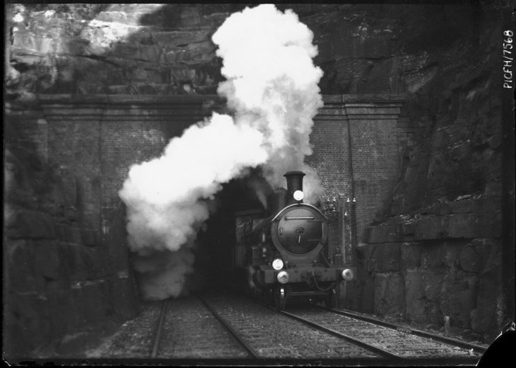 Hawkesbury train emerging from tunnel, New South Wales- by Frank Hurley c1910