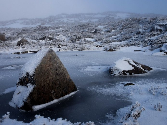A frozen glacial tarn, high on the ridgeline of the Du Cane Range, near Mt Geryon- by Andy Szollosi