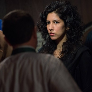 "BROOKLYN NINE-NINE: Det. Rosa Diaz (Stephanie Beatriz, R) chats with Det. Charles Boyle (Joe Lo Truglio, L) in a coat room in the ""The Bet"" episode of BROOKLYN NINE-NINE airing Tuesday, Jan. 14 (8:30-9:00 PM ET/PT) on Fox. ©2013 Fox Broadcasting Co. CR: Eddy Chen/FOX"