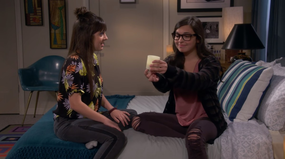 Elena and her girlfriend Syd (Sheridan Pierce) set the mood in a hotel room by turning on a battery operated candle.