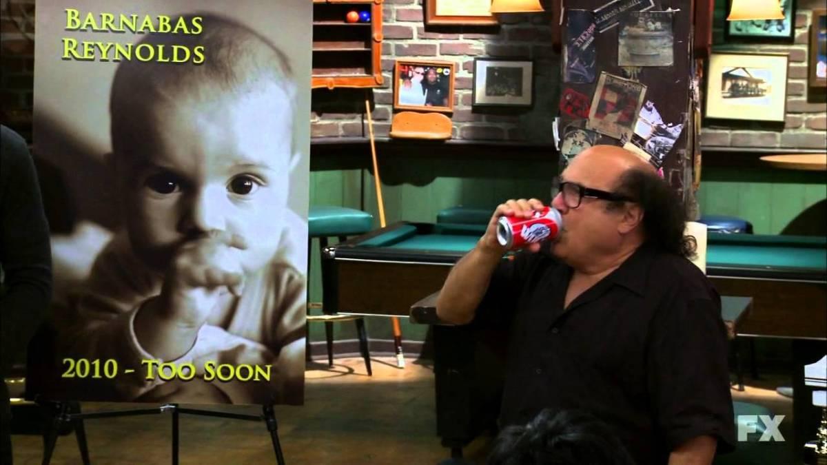 Frank advertising a fake soda at a fake funeral.