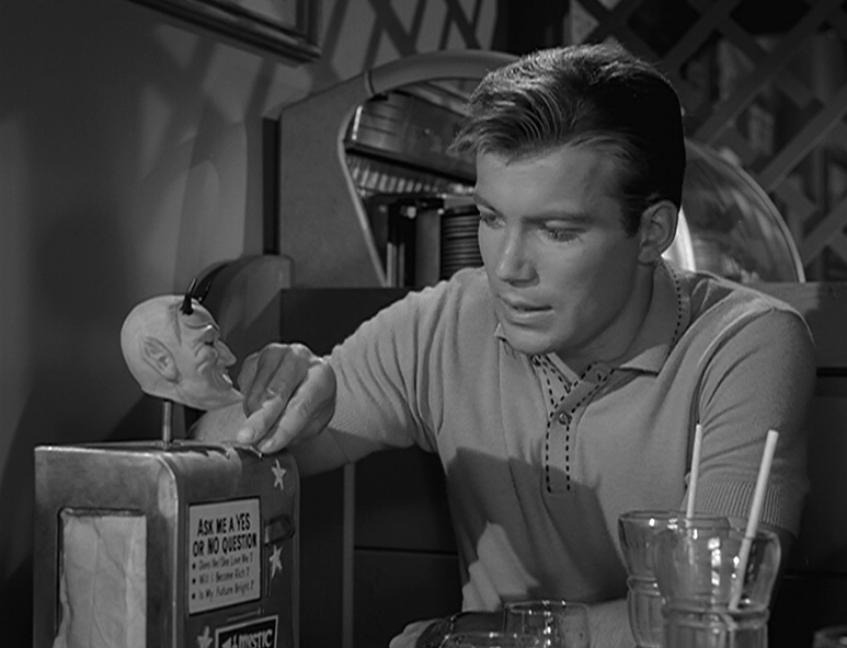 "William Shatner places a penny in a fortune telling machine in the classic Twilight Zone episode ""Nick of Time."""