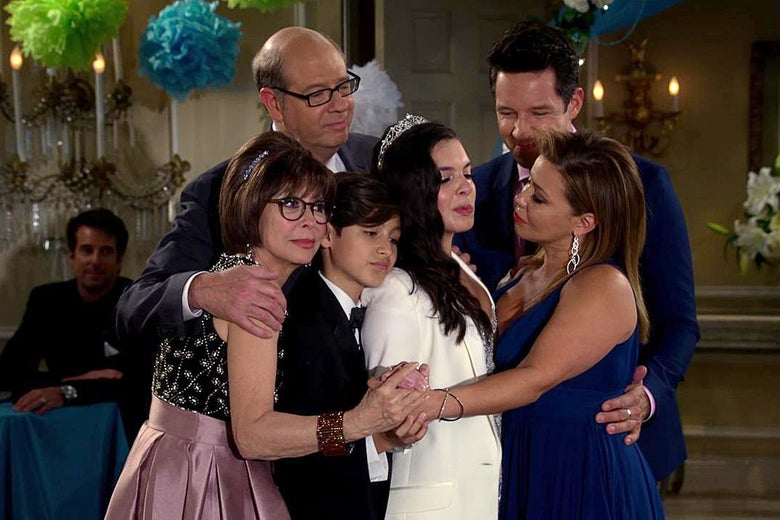 Elena dances with her mother, brother, grandmother, neighbor, and her mother's boss at her Quinceanera celebration.