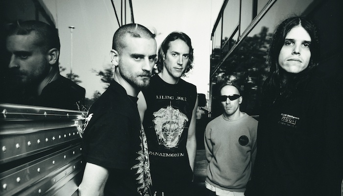 Fear Inoculum: Pictured (right to left): a younger Adam Jones, Maynard James Keenan, Danny Carey, and Justin Chancellor.
