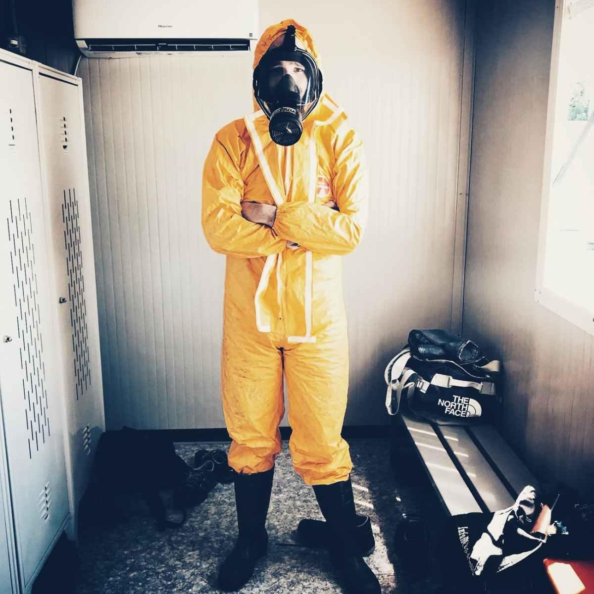 man wearing haphazard suit to avoid zombie infection