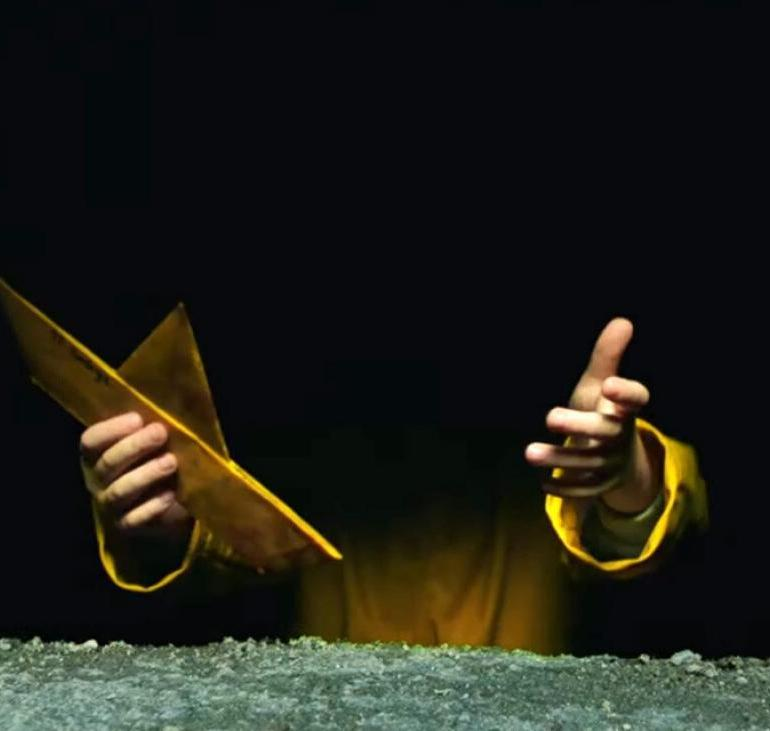 Georgie holding the legendary yellow boat in IT 2.