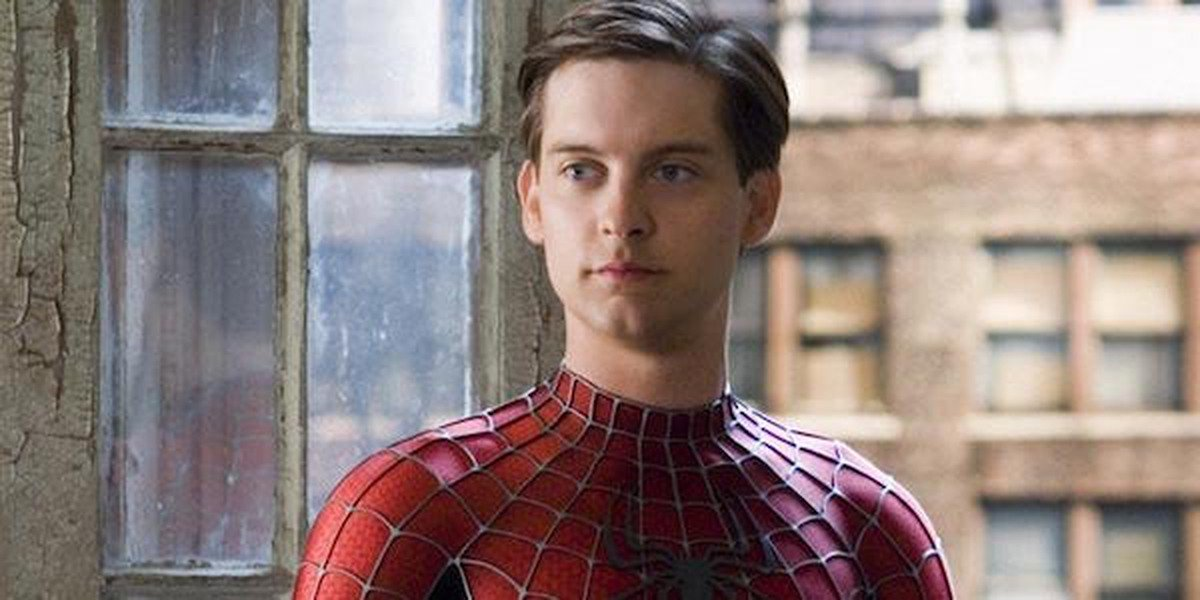 Tobey Maguire's Peter Parker stares pensively, as he does
