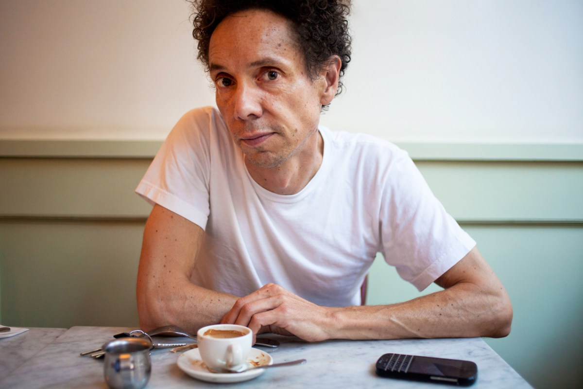 Malcolm Gladwell sitting with coffee.