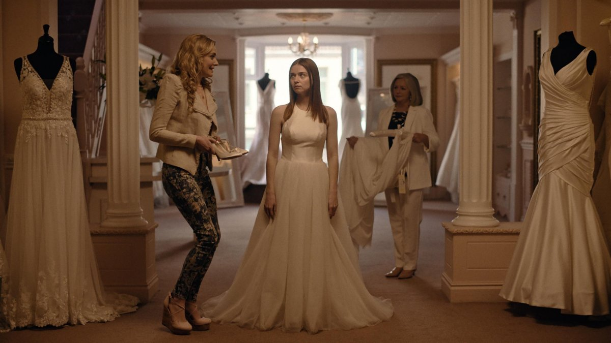 Jessica Barden as Alyssa in her wedding dress.
