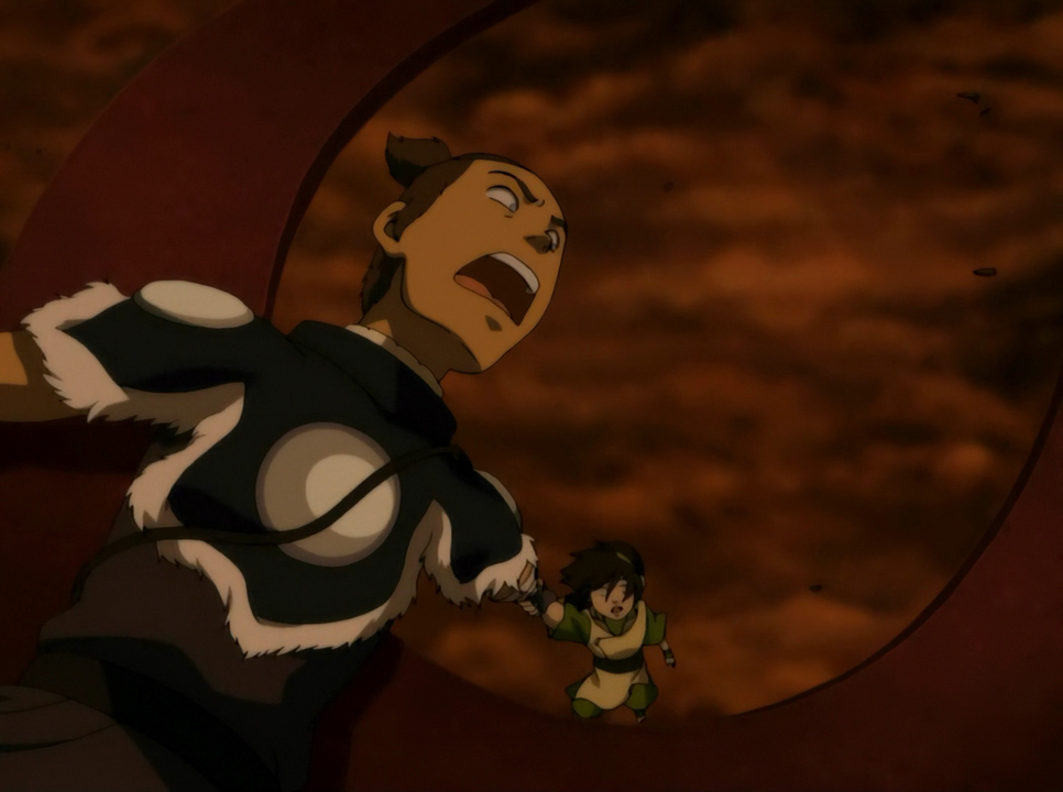 Sokka tries to save Toph from a fiery death.