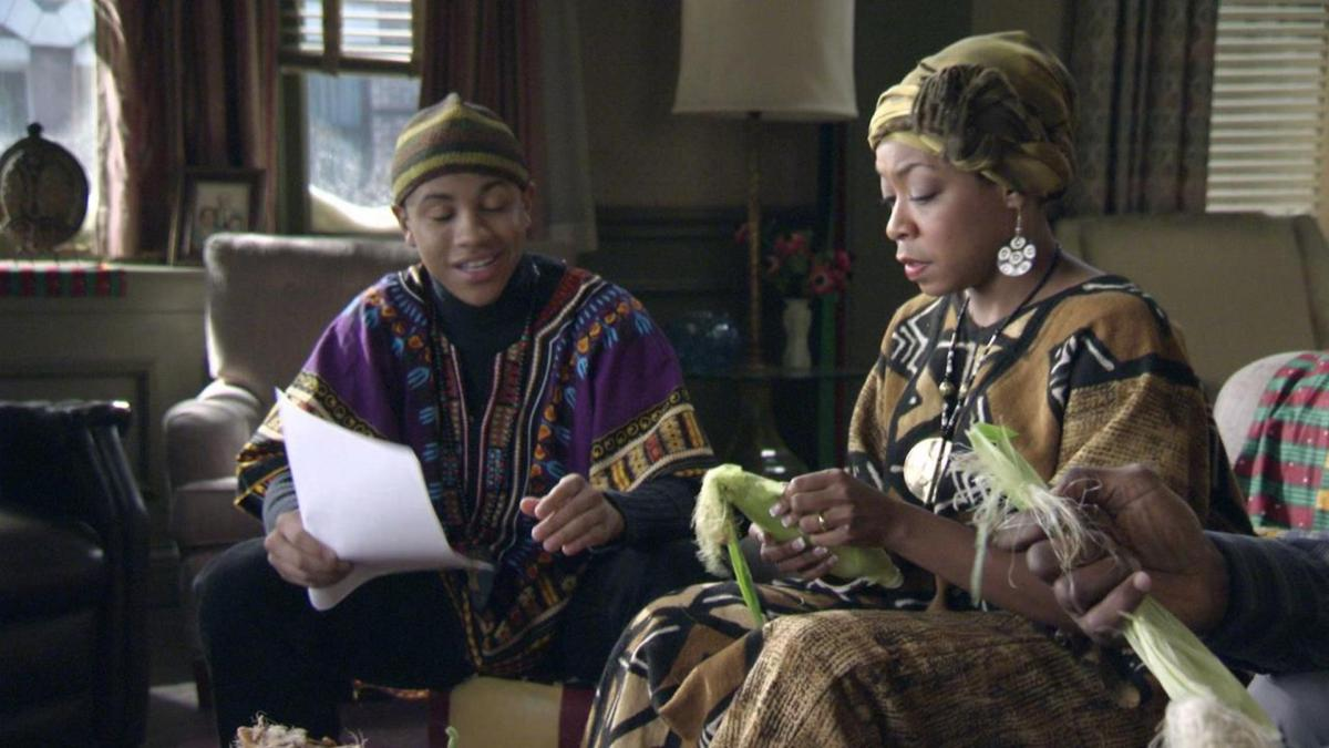 Chris' mother and brother dressed in traditional African clothes celebrating Kwanzaa.