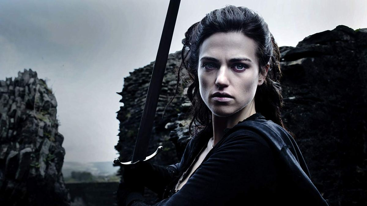 Morgana Pendragon wields a sword on the walls of Camelot