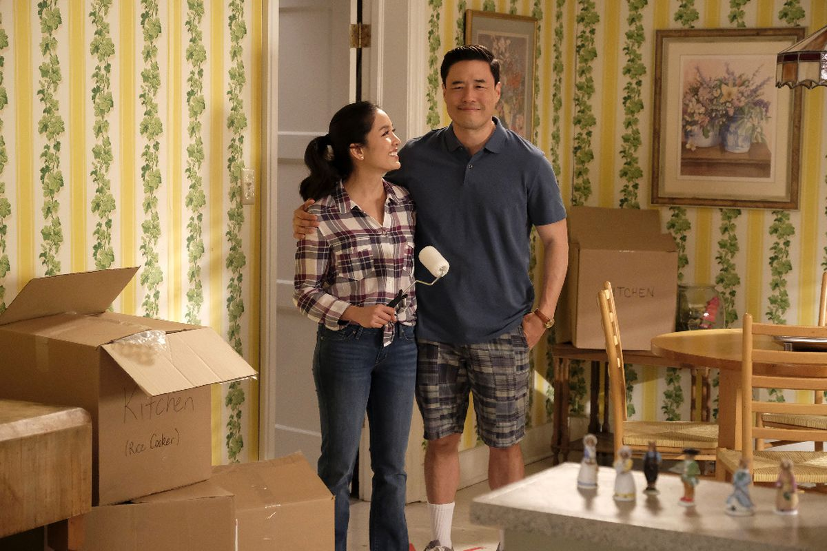 Jessica and Louis happy and surrounded by moving boxes