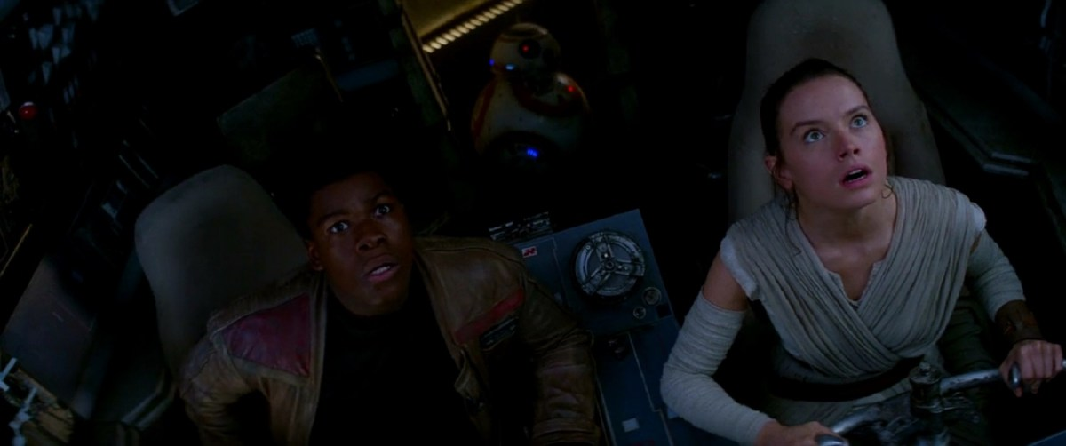 Finn and Rey aboard the Millennium Falcon