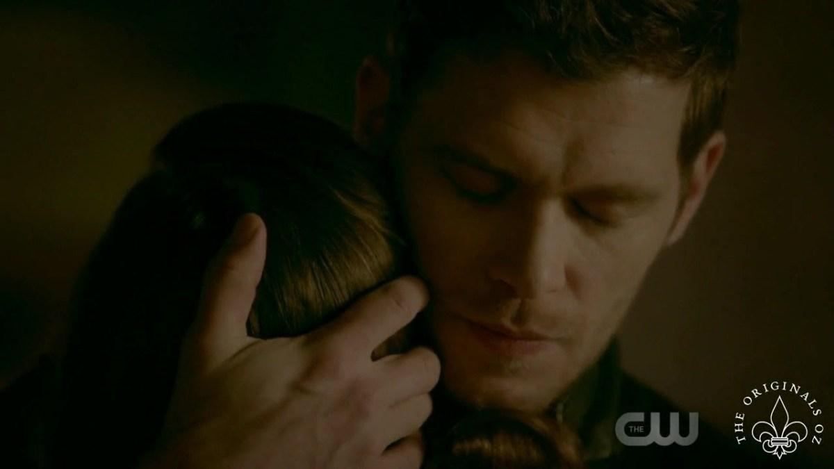 Klaus looking at peace while hugging his daughter goodbye.