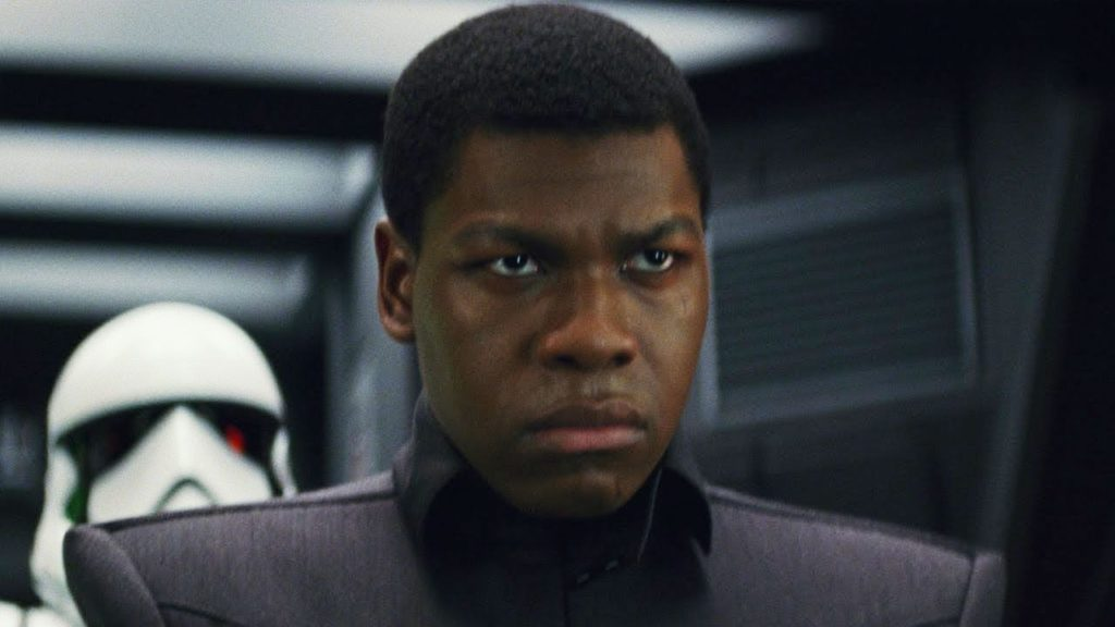Finn wears a First Order uniform to sneak aboard their ship