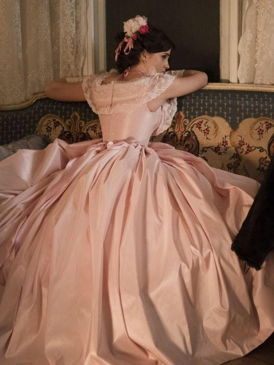 Emma Watson in a beautiful silk pink gown showing off why Little Women is a fantastic choice for best costume design at the oscars.