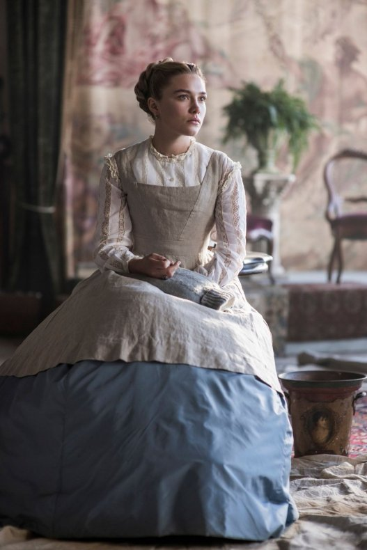 Florence Pugh as Amy in her painters apron.