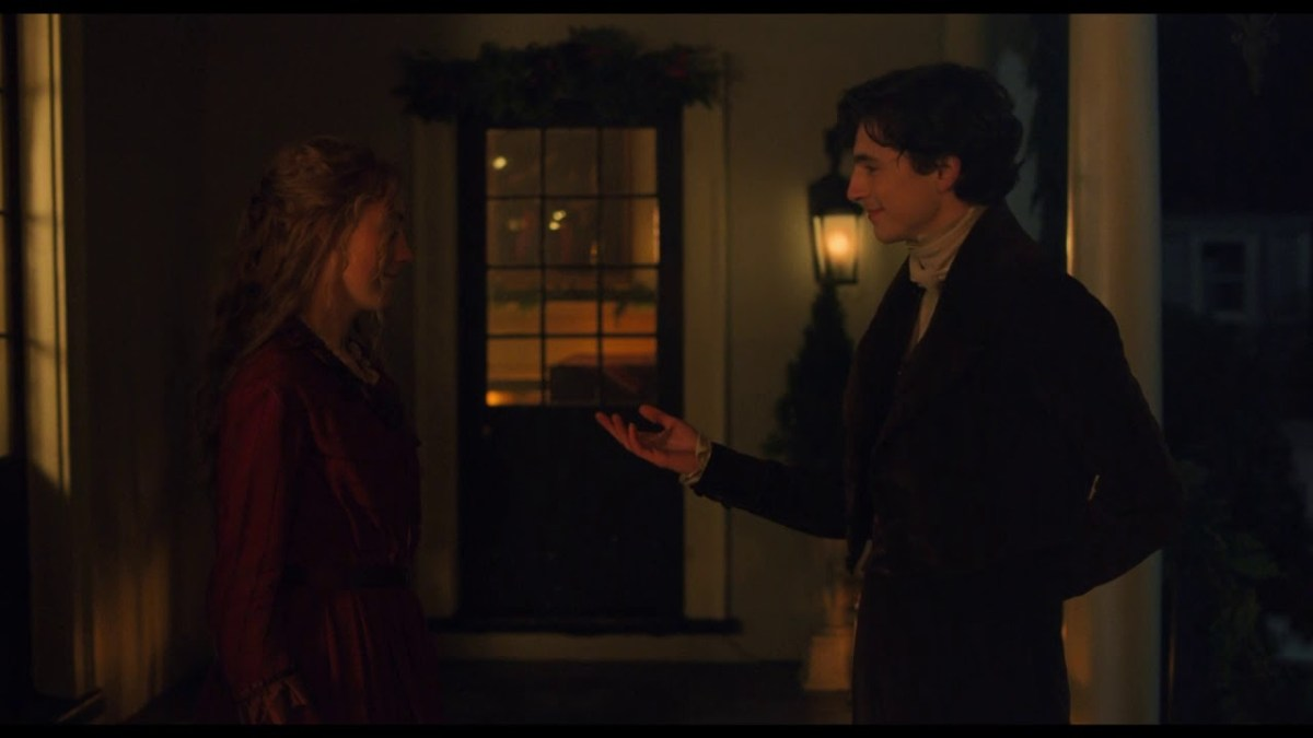 Laurie proposes a dance with Jo just outside of the winter ball