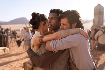 Daisy Ridley, John Boyega, and Oscar Isaac hug on set of The Rise of Skywalker