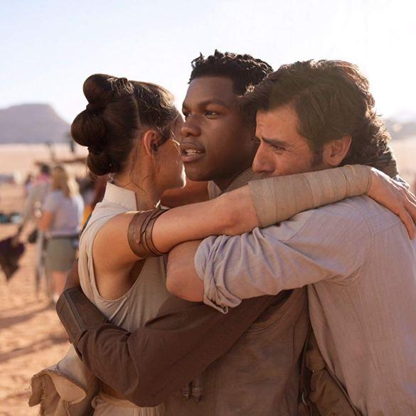 Daisy Ridley, John Boyega, and Oscar Isaac hug on set of The Rise of Skywalker