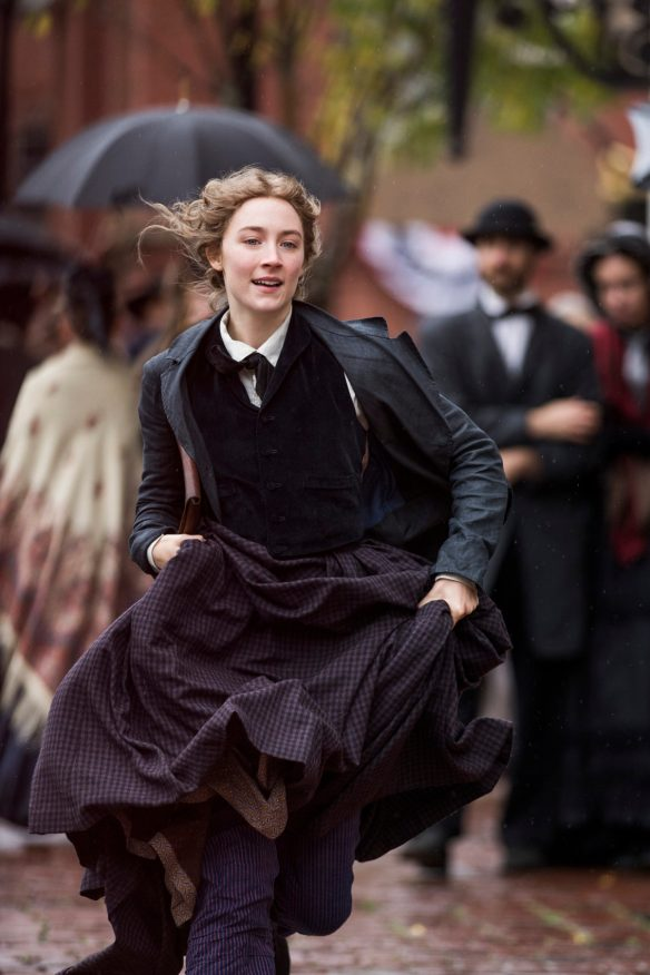 Jo excitedly runs through the streets of New York after her work is bought by a publishing company