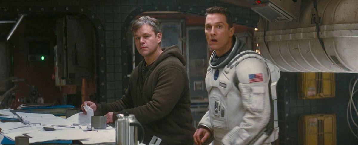 Cooper and Mann inside a spaceship.