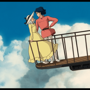 Sophie and Howl stand on the balcony of the now flying castle. They are looking at each other.