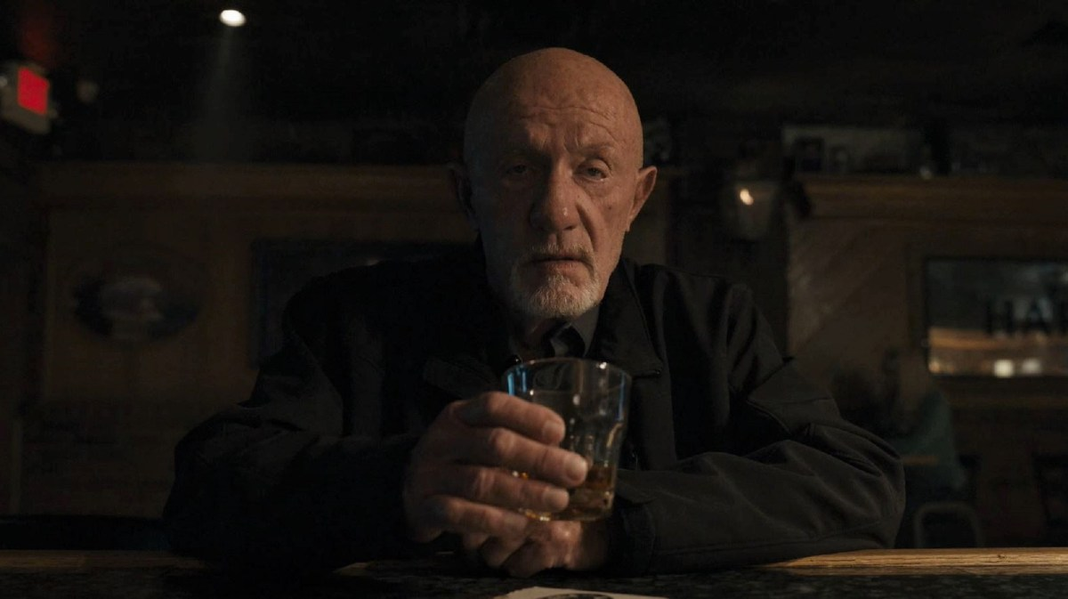 Mike sits at a bar with a drink in his hand in Season 5 of Better Call Saul.