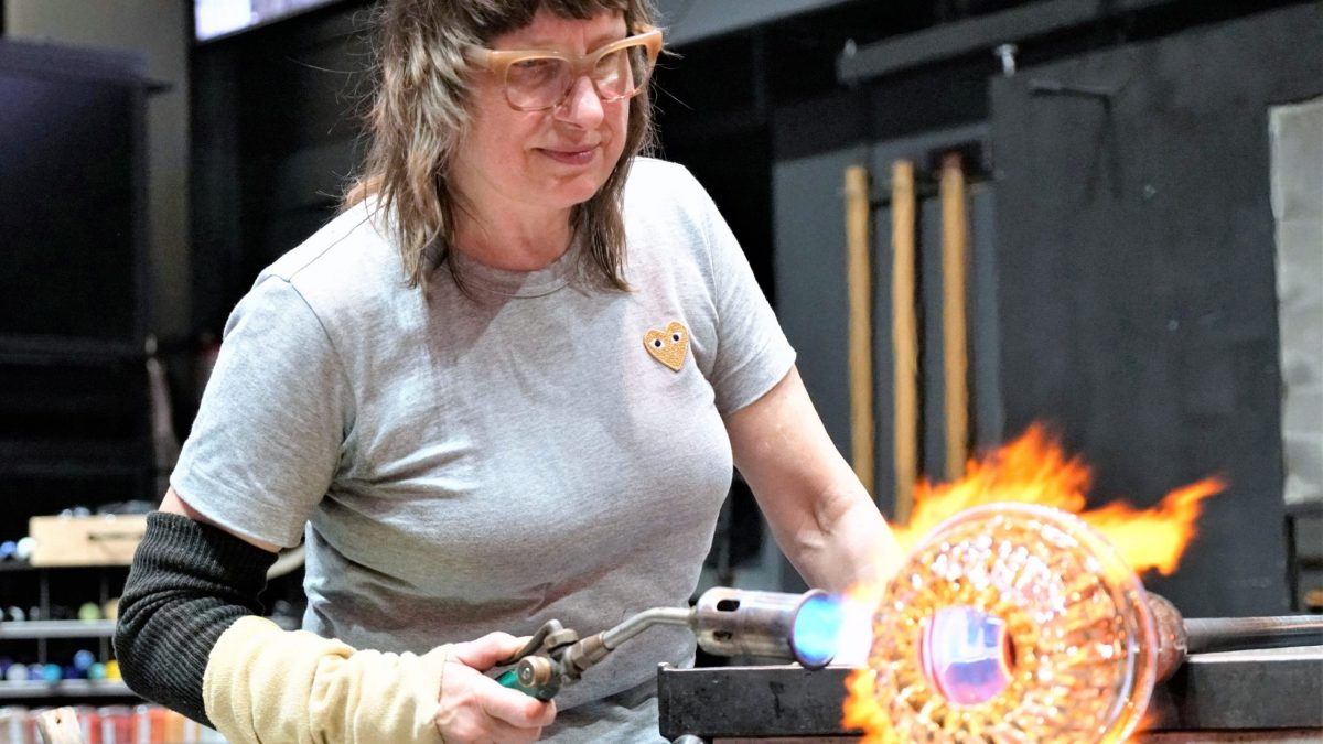 On of the glassblowers torching one of her projects in Blown Away.