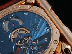 The Manufacture Royale logo engraved on a Sunrayed Geneva wave pattern.