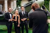 """GOODWOOD, WEST SUSSEX, ENGLAND - AUGUST 4: Viktor Fors, Maria Fagerstroem and Guillaume Laffon attend a black tie cocktail reception followed by a private dinner with the pilots Steve Boultbee Brooks and Matt Jones at Goodwood House to celebrate the official start of the """"Silver Spitfire - The Longest Flight"""" expedition in Goodwood. (Photo by Remy Steiner/Getty Images for IWC)."""