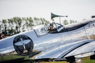 """GOODWOOD, WEST SUSSEX, ENGLAND - AUGUST 5: IWC Schaffhausen and the Boultbee Flight Academy, in collaboration with Aviation Adventures Ltd, have celebrated the official start of the """"Silver Spitfire - The Longest Flight"""" expedition in Goodwood. To the roaring applause of more than 400 guests, the carefully restored and polished Spitfire aircraft embarked on its unprecedented flight around the world (Photo by Remy Steiner/Getty Images for IWC)."""