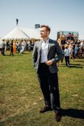 """GOODWOOD, WEST SUSSEX, ENGLAND - AUGUST 5: British actor Taron Egerton attending the celebration of the official start of the """"Silver Spitfire - The Longest Flight"""" expedition in Goodwood. To the roaring applause of more than 400 guests, the carefully restored and polished Spitfire aircraft embarked on its unprecedented flight around the world (Photo by Remy Steiner/Getty Images for IWC)."""