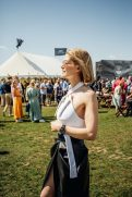"""GOODWOOD, WEST SUSSEX, ENGLAND - AUGUST 5: IWC brand ambassador Rosamund Pike attending the celebration of the official start of the """"Silver Spitfire - The Longest Flight"""" expedition in Goodwood. To the roaring applause of more than 400 guests, the carefully restored and polished Spitfire aircraft embarked on its unprecedented flight around the world (Photo by Remy Steiner/Getty Images for IWC)."""