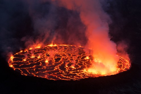 Expedition to Nyiragongo volcano (3470m), active lava lake, biggest lava lake in the world, Nyiragongo's lavas are made of melilite nephelinite, an alkali-rich type of volcanic rock whose unusual chemical composition may be a factor in the unusual fluidity of the lavas there.