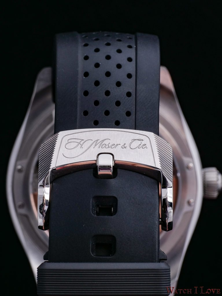 Strap in black alligator leather or black rubber – Steel folding clasp, with engraved H. Moser logo