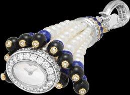 Focus on the hidden dial inside the tassel