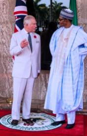 President Muhammadu Buhari chats with Prince Charles at the State House, Abuja.