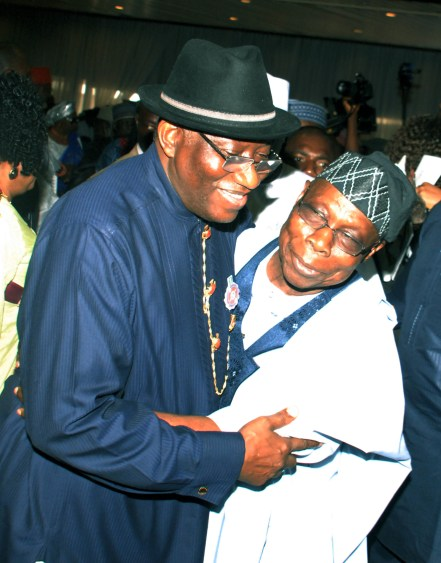 """Former President Goodluck Jonathan with former President Olusegun Obasanjo at the public presentation of """"My Transition Hours"""" held at the Transcorp Hilton Hotel, Abuja... Tuesday Godwin Omoigui"""