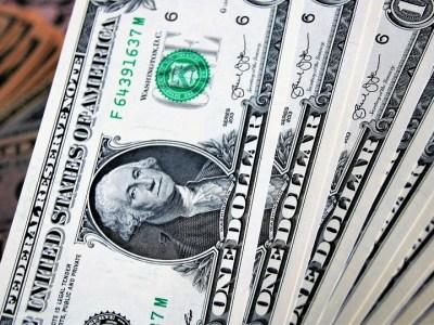 Dólar encerra em queda com mercado aguardando Previdência e G20