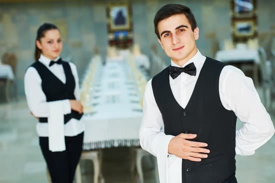 canva-young-waiter-and-waitress-at-service-in-restaurant-MADasGxK4s4.jpg