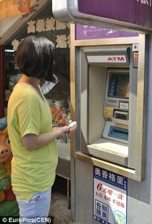 Chinese Woman Gets Electrocuted While Entering PIN Code At An ATM