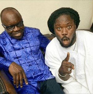 Daddy Showkey strikes a pose with Delta State governor