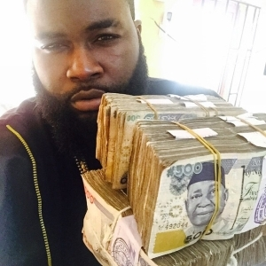 Davido's Hypeman Special Spesh Gets Lashed By Fans For Showing Off Money On Social Media – PHOTO