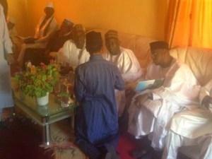 El-Rufai kneels as he discusses with APC national execs in Kaduna.